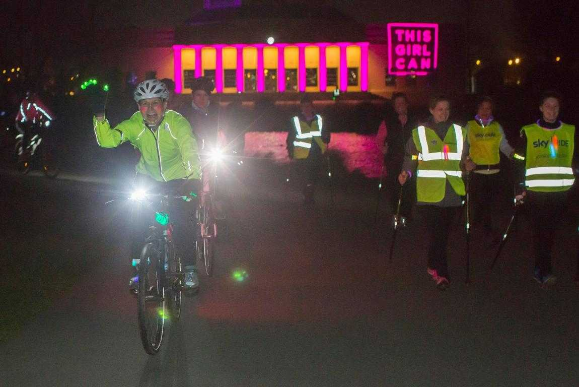 cyclists in uv paint